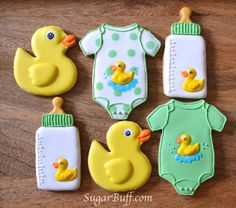 Baby shower cookies		 Sugar Buff : Just Ducky			 Yellow duck, white & green bottle and onesie