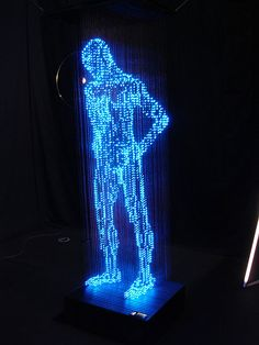 This lighting sculpture by Makoto Tojiki, dubbed The Man With No Shadow, was on show recently at Salone Satellite and features LED threads which form a sta Hanging Light Bulbs, Neon Licht, Mannequin Art, Famous Art, Light Installation, Sculpture Art, Lighting Sculpture, Neon Lighting, Lighting Design