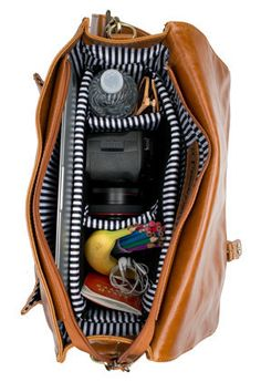 A Beautiful Mess compartment bag - for cameras, baby stuff, whatever, IT HAS AWESOME POCKETS.