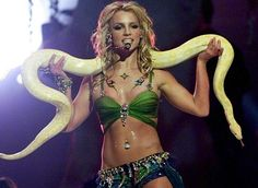 Who could ever forget this historic Britney Spears performance -- snake, belly ring and all? // 2001 MTV VMAs