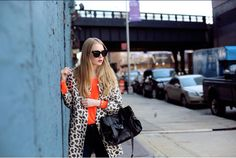Orange sweater with crazy print coat