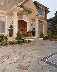 It's where you welcome family and friends and connect with the neighborhood. A Unilock front entrance and walkway creates an inviting transition into your home and connects all the elements of your landscape. Brick Paver Driveway, Paver Walkway, Front Walkway, Driveway Landscaping, Walkway Ideas, Concrete Patio, Patio Edging, Landscape Pavers, Travertine Pavers