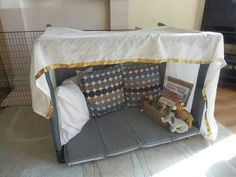 Travel cot reading den, make this for Devin!!! just cover some pvc and a piece of upholstery foam, add corresponding throw pillows!
