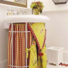 How to do it: Wrap a pedestal sink with a skirt and conceal your waste bin and toiletries below. Stick fabric to the basin edge with adhesive-backed Velcro. Estimated cost: 60-by-32-inch white ruffled cotton sink skirt, about $60; Simply Chic Slipcovers & Simple Linens