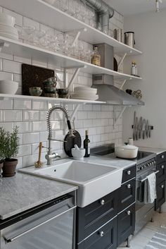 Black kitchen with a green touch - via Coco Lapine Design blog