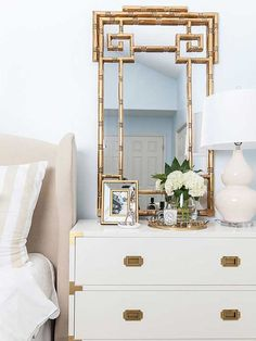 beautiful gold faux bamboo mirror in serene blue master bedroom - 9 Bold Mirrors to Reflect Your Impeccable Style