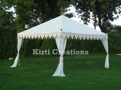 Luxurious Wedding Tent in white color. It stands with 4 steel poles covered by elegant fabrics.