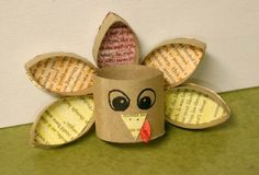 toilet paper roll and scrap paper recycled into a thanksgiving turkey