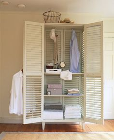 This is a great idea for your storage Amber. Add shutter doors to your book cases to keep avi out of the games. (I think using shutters for the whole cabinet is a little over kill.