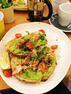 Sourdough toasted ever do lightly served with avocados, smoked salmon scattered with cherry tomatoes. And a wedge of lemon. All from the Vogue Cafe in Sydney . Lovely Enjoy