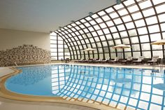 The heated indoor swimming pool at Club Med Hokkaido features vast windows so that swimmers can enjoy the frosty view.