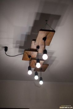 Industrial Decor Project Ideas Project Difficulty: Simple www. Wooden Chandelier, Wooden Lamp, Hanging Chandelier, Rustic Lighting, Home Lighting, Industrial Lighting, Stairway Lighting, Pendant Lighting, Ceiling Design