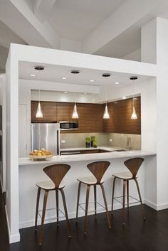 contemporary small kitchen design with custom bar island and unique pendant lights