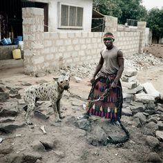 South African photographer Pieter Hugo's series The Hyena and Other Men, photographs of animal wranglers in Lagos, Nigeria have recieved 'va. Hyena Man, Man Images, Baboon, New York Street, Documentary Photography, Animals Of The World, Artist At Work, Pets, Instagram