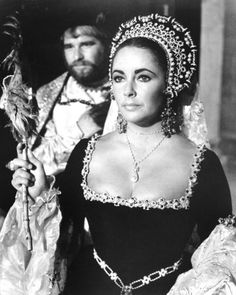 Elizabeth Taylor, in a tiny bit part as a Reveler in the film, 'Anne of a Thousand Days', wearing La Peregrina, the magnificent pearl given to Mary I, by Philip of Spain, purchased by Richard Burton for Elizabeth.