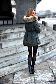 Beautiful winter outfit. Dress, tights, ankle boots and a big jacket.