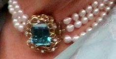 From Her Majesty's Jewel Vault: The Duchess of Cornwall's Three Strand Pearl Choker with Aquamarine Clasp
