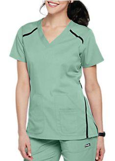 The Grey's Anatomy Impact Elevate Three Pocket Scrub Top is made of comfy stretch fabric. Scrubs Outfit, Scrubs Uniform, Cute Nursing Scrubs, Stylish Scrubs, White Lab Coat, Corporate Uniforms, Greys Anatomy Scrubs, Medical Scrubs, Scrub Tops