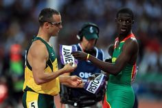 Admiration knows no boundaries- Oscar Pistorius of South Africa exchanges bibs with Kirani James of Grenada after the Men's 400m semifinal on Day 9 of the London 2012 Olympic Games at the Olympic Stadium on August 5, 2012 in London, England. (Photo by Phil Walter/Getty Images)