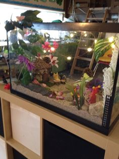 Repurposed fish tank made into a fairy garden