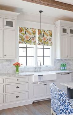 See Ballard Designs' Marcello Barstools in this bright white kitchen with a colorful personality