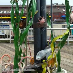 Fun #Sculpture on the #SeattleWaterfront in #Seattle.  #publicart #NWRoadtrips #fish #seaweed #art