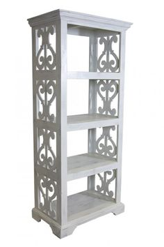 An organized space shouldn't sacrifice style! The Harp Bookcase displays a rustic style that complements traditional and casual spaces nicely. Its pleasantly distressed wood tone in white illuminates the woodwork put into this design. Finial motifs cascade the sides of this bookcase to generate an elegant appeal, decorating your display of framed achievements, favorite books, or precious photographs. #bookshelf #displayshelf #homeoffice #homelibrary #livingroom #diningroom #den #bookcase