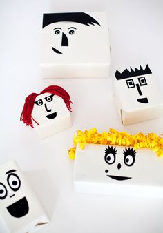 Gift Wrapping With Faces. Fun!
