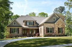 Architectural Designs Exclusive House Plan 29886RL has stunning exterior and a lovely master suite on the main level. An optional finished lower level opens to the back if you have a sloping lot. Ready when you are. Where do YOU want to build?