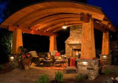 Sweet outdoor space, but probably a little overdone for most of us.  Smaller beams and a more simple roof would make this more cost and material efficient.