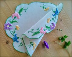 Check out this item in my Etsy shop https://www.etsy.com/uk/listing/562267587/vintage-embroidered-sweet-pea-linen