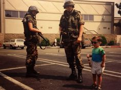 6.) During the 1992 riots in Los Angles, a young child poses with National Guard troops.