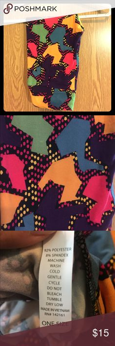NWOT OS Leggings by LLR! Never worn, never tried on OS (one size) Leggings by LLR. Black background with multiple colors in pattern. Can be worn with a variety of tops! Smoke free home. LuLaRoe Pants Leggings