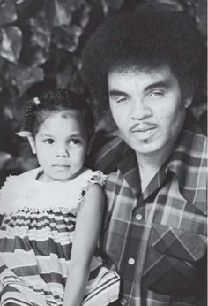 Young Janet Jackson with her dad Joe Jackson