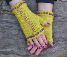 Hand knitted romantic wrist warmers in yellow and violet colors, decorated with lilac beads. Fingerless gloves are perfect for typing, driving,