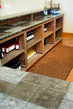 Materials: Reclaimed redwood cabinetry. Mixed metal top by Nate Brigham. wine, metal bar top, counter top, warehous, mix metal, metal counter, basement counter, shelv, mixed metals