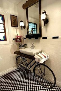 Repurpose old bike into a sink! Love the use of the basket to hold towels...what do you think??