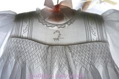 Bodice of smocked and embroidered christening gown
