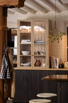 Beautiful glazed countertop cupboards made from sustainable timber, copper worktops and hanging mistletoe
