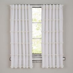 Sheepish Curtains - curtains help a room feel finished and cozy. these curtains are nice & simple, but with a touch of fun in the pompoms.