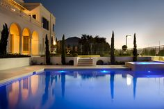 Aloha Pools Pty Ltd custom developed this formal pool in Mt Eliza, Victoria, Australia. The visual transition between this gorgeous modern mansion and striking pool design is seamless. The timelessness of the strong, classic lines and traditional elements unites the pool and house as one enrapturing space.