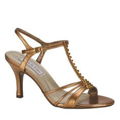 Fascinating ankle strap sandal featuring a metallic synthetic upper with a rhinestone covered t-strap and a classy high heel. Available Colors: Bronze Metallic, Silver Metallic, Gold Metallic.