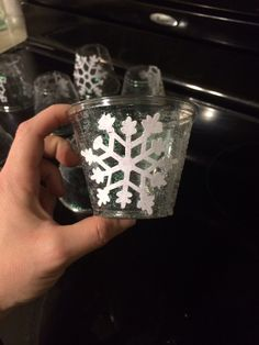 Frozen birthday party. Super easy idea, glue paper snowflakes and add glitter to clear plastic cups. Cute for a snowflake party too.