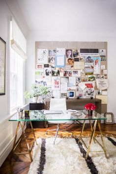 The brass sawhorse legs of this office desk are great but it's the inspiration wall in back that really caught our eye.