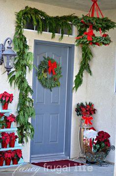 Stacked Poinsettia Tree Shelf & Christmas Wreath Chandelier |
