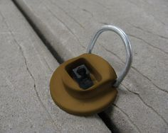 Deck Down Deck Anchors secure your deck furniture and items to your deck with a simple slip-zip-clip!