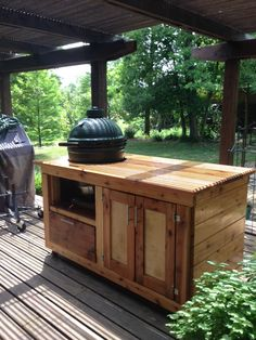Big Green Egg Table Constructed From Red Cedar Complimented With Stainless  Steel Hardware And Casters.