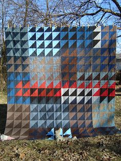 half-square triangle quilt - how can some people make solids look so interesting? and how can she combine gray and brown in one quilt? le sigh...