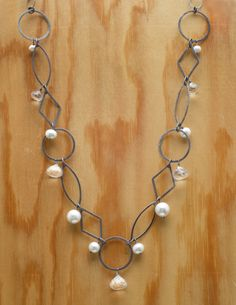 Oxidized silver chain with quartz and freshwater pearls.  http://www.calliope-jewelry.com/pools/n234