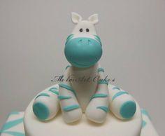 Gum paste Zebra topper for baby boy shower cake.